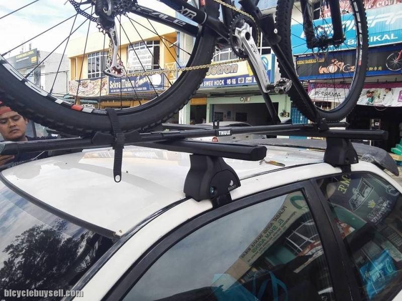 Rhino cross bar and bicycle rack
